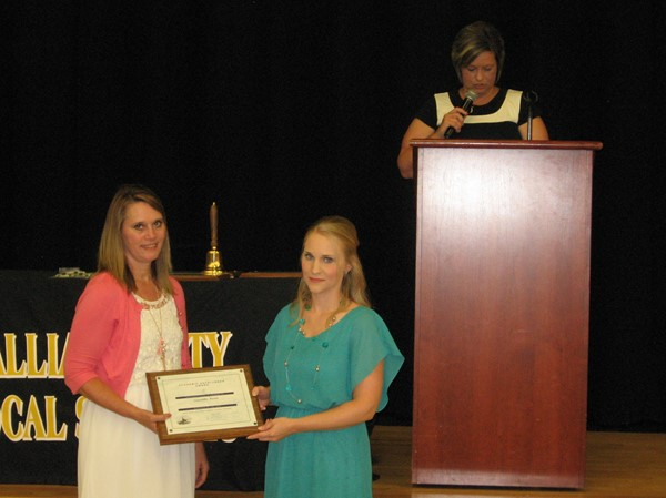 Teacher of the year Samantha Martin with Sandra Plantz and Rochelle Halley at podium.